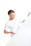 Lycklig tonåring som rymmer ett tomt baner isolerat på vit Royaltyfria Bilder