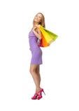 Lycklig tonårs- flicka med shoppingpåsar fotografering för bildbyråer