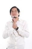 Lycklig ung asiatisk affärsman Praying Arkivbild