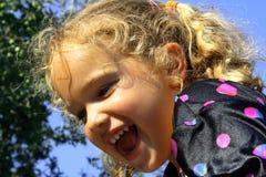 Lycklig ung blond flicka Fotografering för Bildbyråer
