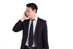 Lycklig ung Caucasian affärsman som rymmer en mobiltelefon Arkivbilder