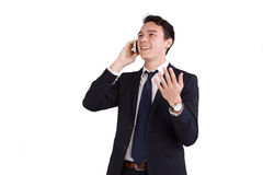 Lycklig ung Caucasian affärsman som rymmer en mobiltelefon Arkivfoto