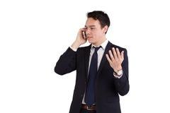 Lycklig ung Caucasian affärsman som rymmer en mobiltelefon Royaltyfri Bild