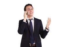 Lycklig ung Caucasian affärsman som rymmer en mobiltelefon Royaltyfri Fotografi