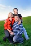 Lycklig ung familj Arkivbilder
