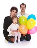 Lycklig ung familj med ballonger Arkivbild