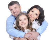 Lycklig ung familj på en vit bakgrund royaltyfri bild