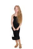 Lycklig ung flicka med en handväska Royaltyfri Bild