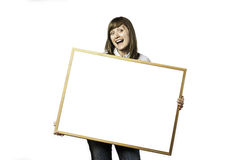 Lycklig ung flicka med tom whiteboard Fotografering för Bildbyråer