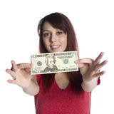 Lycklig ung kvinna som visar räkningen för US dollar 20 Arkivbild