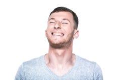Lycklig ung man på vit Arkivfoto