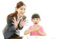 Lycklig ung student med läraren arkivbild
