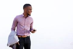 Lycklig ung svart grabb med en mobiltelefon Royaltyfria Foton