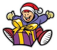 Lycklig unge med en julgåva Arkivbilder
