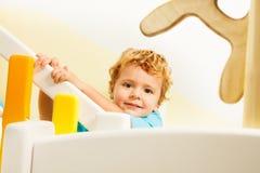 Lycklig unge på lekplats Fotografering för Bildbyråer