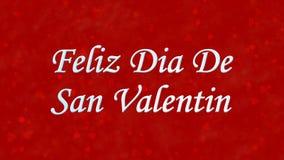 Lycklig valentin dagtext i spanska Feliz Dia De San Valentin på röd bakgrund Fotografering för Bildbyråer