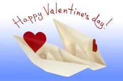 Lycklig valentindag! De pappers- fartygen med hjärtor Arkivbild