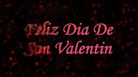 Lycklig valentins dagtext i spanska Feliz Dia De San Valentin vänder till damm från vänstert på mörk bakgrund Arkivbilder