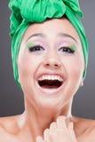 lycklig visande le tandkvinna Royaltyfri Fotografi