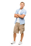Lyckliga armar för ung man vek isolerat på vit bakgrund Arkivbild