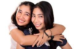Lyckliga asiatiska bästa vän, över vit Royaltyfria Foton