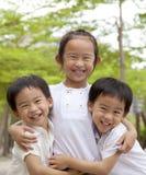 lyckliga asiatiska barn Fotografering för Bildbyråer
