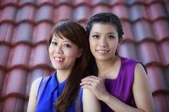Lyckliga asiatiska flickor Arkivbild