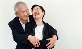 Lyckliga asiatiska höga par Framgång i affären och liv, togher arkivfoton