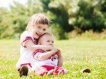 Lyckliga barn i folk kläder Royaltyfria Foton