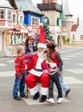 Lyckliga barn och Santa Claus Fotografering för Bildbyråer