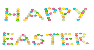 Lyckliga bokstäver easter, kulöra candys som isoleras på Royaltyfria Foton