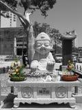 Lyckliga Buddha festmåltid Arkivbild