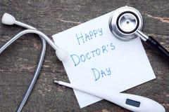 Lyckliga doktorer dag för inskrift arkivfoto