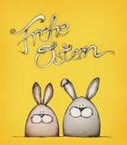 Lyckliga easter med två easter kaniner Arkivfoto