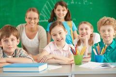 Lyckliga elever Arkivbild