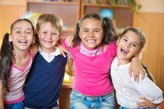 Lyckliga elever på skolan Fotografering för Bildbyråer