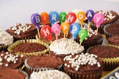 lyckliga födelsedagchokladmuffiner Fotografering för Bildbyråer