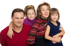 Lyckliga föräldrar med barn Fotografering för Bildbyråer
