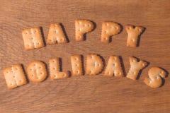 Lyckliga ferier för önska från kakor arkivfoto