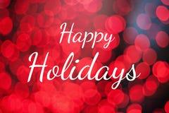 Lyckliga ferier för text på rött ljusbokehbakgrund Arkivfoto