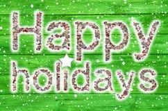 Lyckliga ferier: Julhälsningkort med text av en collage I Arkivfoto