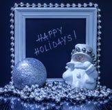 Lyckliga ferier smsar i en vit träram med en snögubbe, silv Fotografering för Bildbyråer