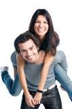 lyckliga gladlynt par på ryggen Arkivfoton