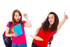 Lyckliga högskolestudenter Arkivbild