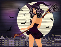 lyckliga halloween Sexig ung häxanattstad Royaltyfri Bild