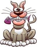 Lyckliga inhemska Cat Chewing en fisk Arkivbilder