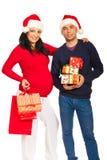Lyckliga julframtidsföräldrar Arkivbild