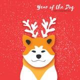 2018 lyckliga kinesiska hälsningkort för nytt år Kinesiskt år av hunden PapperssnittAkita Inu vovve med horn snow Arkivbilder