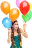 Lyckliga kvinnaholdingballonger Royaltyfri Foto