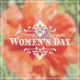 Lyckliga kvinnors dag 8 mars på unfocused blom- Arkivfoton